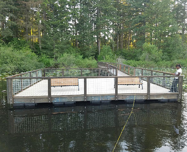 Floating Dock Project with Forested Background